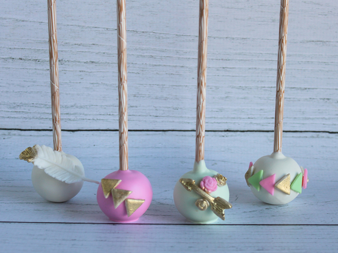 pastel cake pops with arrows and feathers