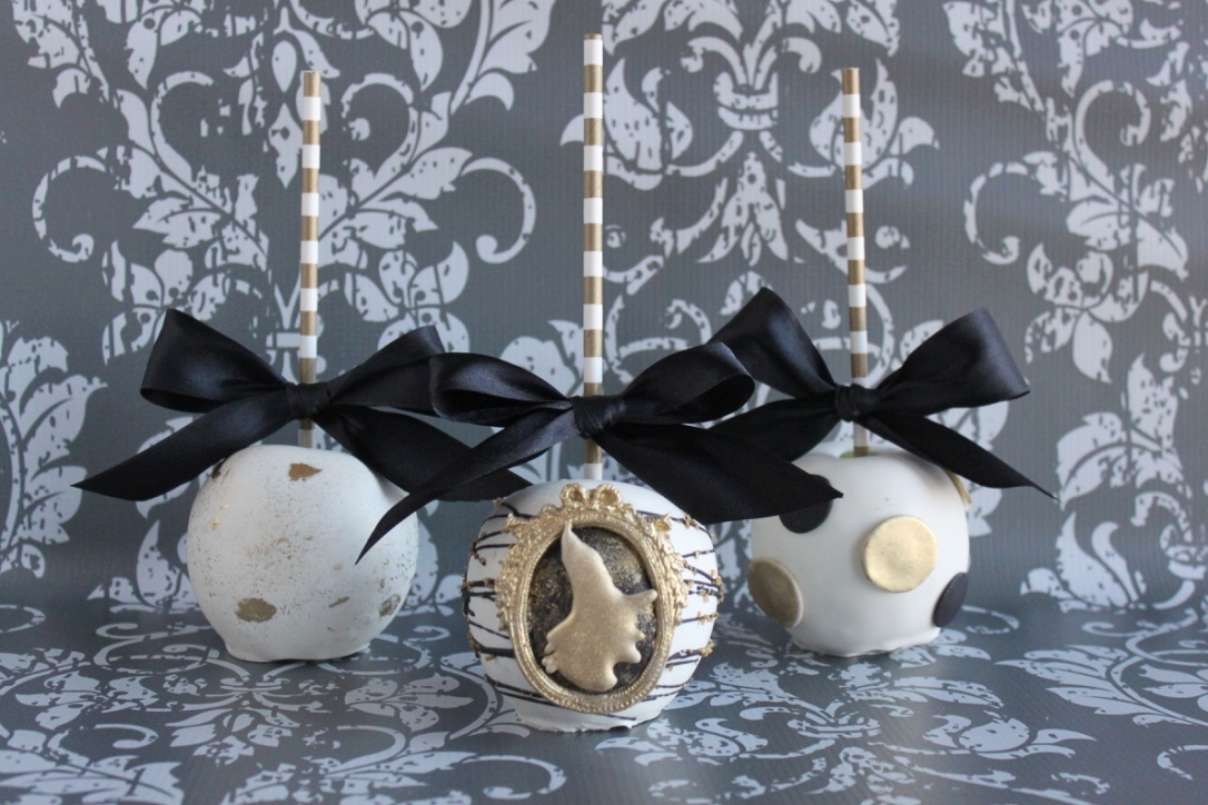 gold, black and white witch candy apples
